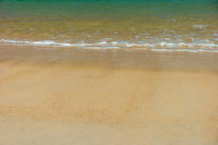 Wave of the sea on the sandy beach Stock Images
