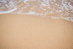 Wave of the sea on the sandy beach texture background with copy space.  stock photo