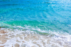 Wave of sea on sandy beach Royalty Free Stock Photos
