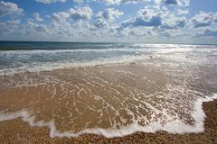 The wave at the seashore. Seashore with waves and clouds Stock Photography
