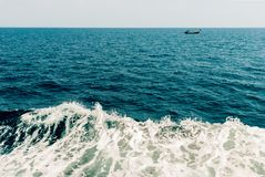 Wave of ship on water surface in the sea Royalty Free Stock Photography