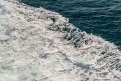 Wave of ship on water surface in the sea Stock Images
