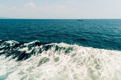 Wave of ship on water surface in the sea Royalty Free Stock Photo