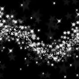 Wave of silver stars. On a black background Royalty Free Stock Images