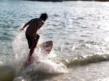 Wave skim boarding Royalty Free Stock Image