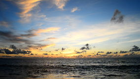 Wave and sky at beach stock footage
