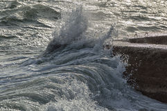 Wave. Slaming concrete pier during stormy seas Royalty Free Stock Photography