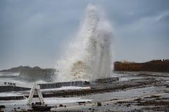 Wave smashes sea wall Stock Photo