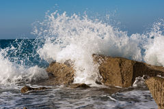 Wave Smashing Rocks Stock Image