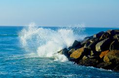 Wave Smashing in a Sprial off a Jetty stock photo