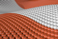 Wave of spheres in the colors of Austria. Wave of hundreds of glossy, reflective spheres with the colors of the Austrian flag. Shallow depth of field Royalty Free Stock Photos