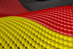 Wave of spheres in the colors of Germany. Wave of hundreds of glossy, reflective spheres with the colors of the German flag. Shallow depth of field Stock Images