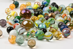 Wave of spilled colorful glass marbles Royalty Free Stock Image