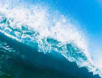 Wave Splash. Blue Ocean Wave Crashing Down,  Perspective from under the lip of the wave Royalty Free Stock Image