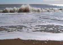 Wave Splash. Waves splashing onto the beach - colour image Royalty Free Stock Photos