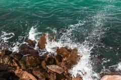 Ocean shore. Wave splash in ocean against beach reef Stock Photos