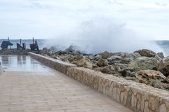 Wave splash panorama Cala Estancia pier Royalty Free Stock Image