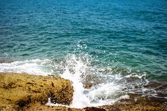 Wave splash in the sea at rock Stock Photography