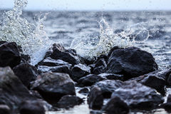 Wave splash and stones Royalty Free Stock Photos