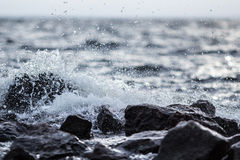 Wave splash and stones Stock Photography