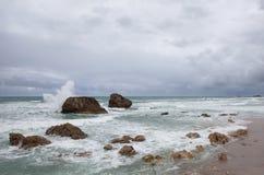 Wave splashes Stock Image