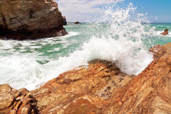Wave and splashes on beach of cathedrals in ribadeo, Galicia, Sp Stock Images
