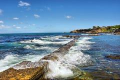 Wave splashes on pier Royalty Free Stock Image