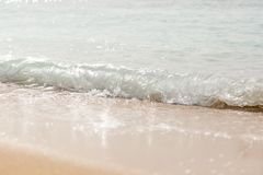 Wave splashing on a beach. close up.  stock photos