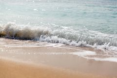 Wave splashing on a beach. close up.  stock photography