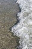 Wave splashing on the beach Royalty Free Stock Image