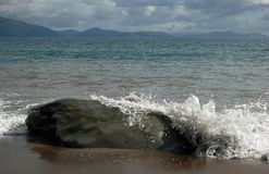 Wave splashing irish rock Stock Photo