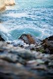 Wave splashing moss rock. Milky white wave. Close up shot royalty free stock photos