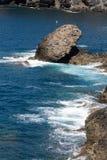 Wave splashing over a rock on Caleta Negra beach in Ajuy  on Fuerteventura. Stock Image