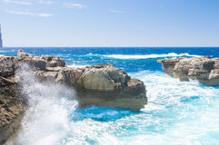 Wave splashing on the rocky coast near missing Azure Window in Gozo Island, Malta. Stock Photo