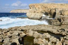 The rocky coast near missing Azure Window in Gozo Island, Malta. Wave splashing on the rocky coast near missing Azure Window in Gozo Island, Malta Royalty Free Stock Photo
