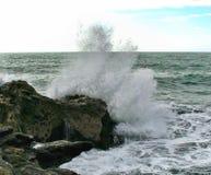 A wave splashing on the rocky shoreline, Charleston, New Zealand stock photography