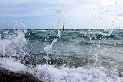 Wave Splatter. On seaside Thailand Royalty Free Stock Photo