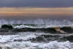 Wave spray at dusk Royalty Free Stock Images