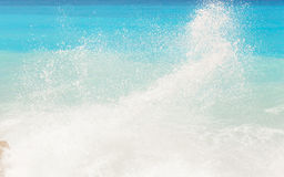 Wave spray and turquoise blue sea water Royalty Free Stock Photo
