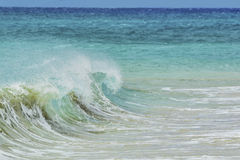 Wave spraying on the shore. Of the beach of sotavento in fuerteventura canary islands Stock Photo