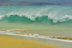 Wave spraying on the shore Stock Images