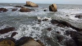 Wave and the stone. View near beach at Teluk Cempedak, Kuantan stock footage