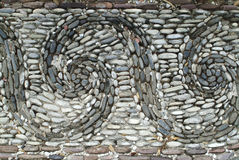 Wave of stones. A floor of waves made with rounded stones Royalty Free Stock Photo