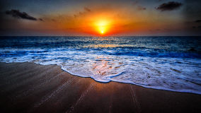 Wave stripes. Sunset photo of a brown beach Royalty Free Stock Images