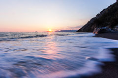 The wave. Wave during sunset in the Ligurian Sea stock photos