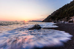 The wave. Wave during sunset in the Ligurian Sea stock photo