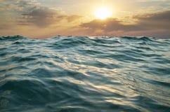 Wave on sunset. Stock Photo