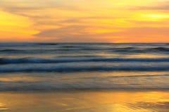 Wave at sunset. Slow speed sea wave at sunset time, Parangtritis Beach, Jogjakarta, Indonesia Stock Photos