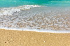 Wave of surf on the sea coast, clean sea shore and turquoise water stock photos