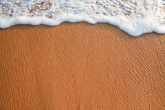 Wave surging on sand Royalty Free Stock Images